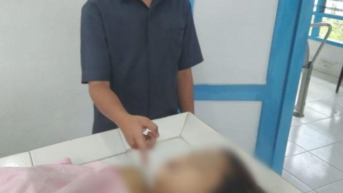 korban saat berada di Rumah Sakit Umum keruang IGD untuk dilakukan visum.,foto ist