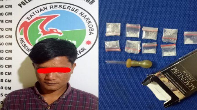 Reno (30) dan barang bukti 9 (sembilan) paket narkotika diduga jenis shabu yang diamankan Satnarkoba Polres Siantar