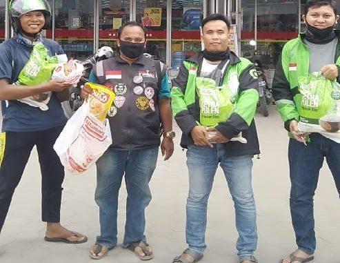 Mitra Gojek sedang menukarkan voucher di salah satu Alfamart di Siantar