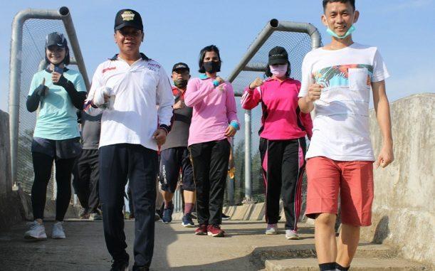 Kapolres Sergai bersama personel menggelar kegiatan olahraga Hash, Minggu (15/6/2020)