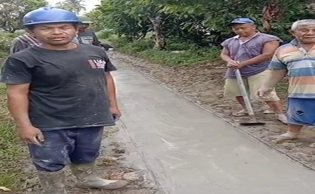 Partisipasi Calon Bupati Simalungun nomor 1, Radiapoh Hasiholan Sinaga (RHS), dengan memberikan bantuan semen, batu dan semangat gotong-royong, jalan di Huta Buntu Marihat bisa terbangun.