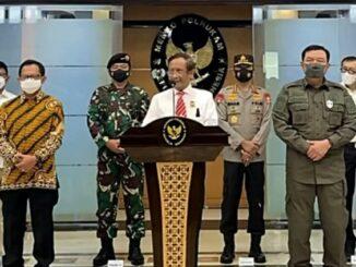 Menko Polhukam Mahfud MD saat konferensi pers hentikan kegiatan FPI, Rabu (30/12).